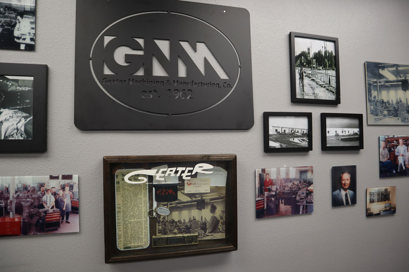 image frames of Geater throughout the years on company wall