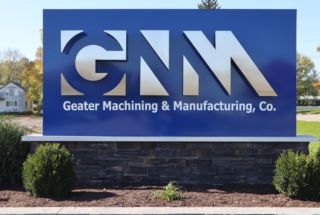 Geater Machining & Manufacturing, Co. custom sign in from of company building