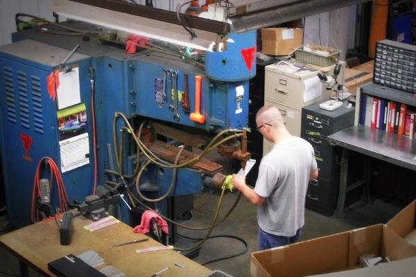 employee working at welding machine